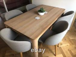 6 dining chairs by MADE. Com in grey upholstered fabric. Barely been used