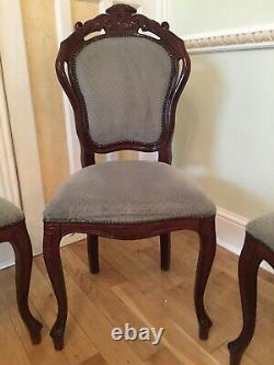 A Set of 4 Rosewood Dining chairs with Grey Upholstery