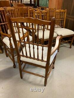 A Set of Ten Solid Oak Upholstered Spindle Back Dining Chairs
