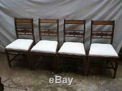 A set of four late victorian dining chairs. Upholstered in calico