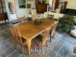 Arts & Crafts Dining Suite. Extending Table & Six Oak Upholstered Dining Chairs