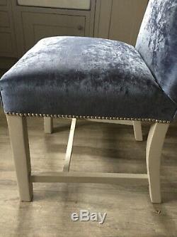 Blue velvet bespoke upholstered dining chairs, silver studs, light grey legs