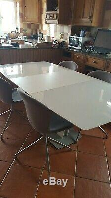 Bo Concept Milano Extendable Dining table with custom upholstered swivel chairs