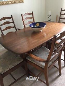 Ercol Solid Wood Dining Table and 6 Chairs 4 carvers all upholstered