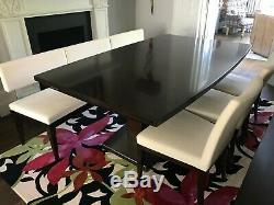 Extendable Selva dining table with upholstered dining chairs and bench seating
