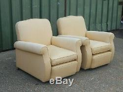 Fabulous pair of Victorian re-upholstered lounge armchairs with traditional arms