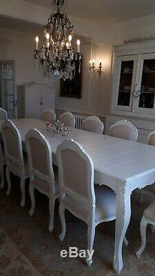French set of 12 carved and upholstered dining chairs (table listed separately)
