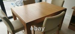 Habitat Used solid oak extending dining table and 8 upholstered chairs
