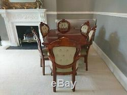 Italian Style Dining Room Table And 6 Chairs Upholstered In light green Material
