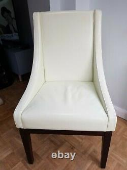 Leather upholstered Sloping Chairs