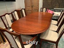 Nathan extending dining table and eight upholstered chairs