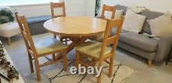 Natural Solid Oak 4 Seater Round Dining Table with 4 Leather Upholstered Chairs