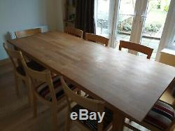Oak dining table and 8 oak & upholstered chairs, in good condition. Ikea