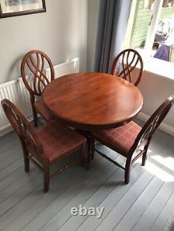 Round Extending Mahogany Dining Table + 4 dining upholstered chairs