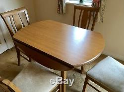 Round HJ Berry light oak drop leaf dining table and 4 upholstered chairs