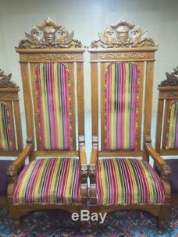 Set Of Eight Highly Ornate Hand Carved Solid Oak Gothic Upholstered Thrones