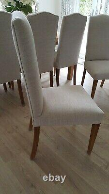 Set of 8 quality Dining Chairs recently re-upholstered in natural linen