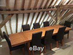 Solid Oak extending dining table and 8 Leather Upholstered chairs