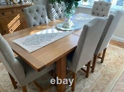Solid oak dining table and upholstered chairs Laura Ashley fabric