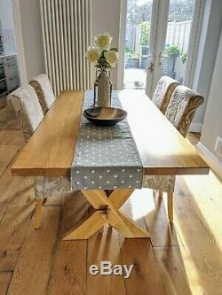 Solid oak dining table with 6 upholstered chairs (2 chairs not pictured)