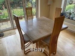 Square marble dining table and four recently re-upholstered chairs