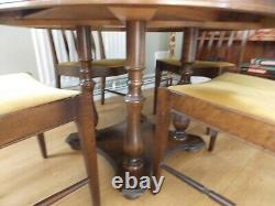 Stag dining table and 4 upholstered chairs