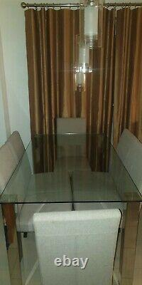 Used glass dining table and upholstered chairs